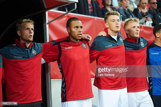 Jonas Lossl Mathias Zanka Jorgensen Nicolaj Thomsen and Daniel Wass of Denmark sing the national anthem prior to the international friendly match...