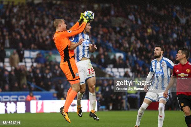 Jonas Lossl of Huddersfield Town and Christopher Schindler of Huddersfield Town during the Premier League match between Huddersfield Town and...