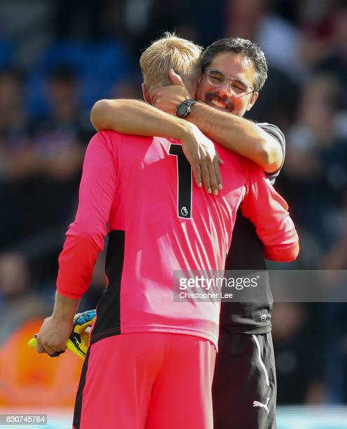 Jonas Lossl of Huddersfield Town and David Wagner Manager of Hudersfield Town celebrate victory after the Premier League match between Crystal Palace...