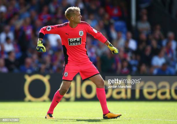 Jonas Lossl of Huddersfield Town celebrates his sides third goal during the Premier League match between Crystal Palace and Huddersfield Town at...