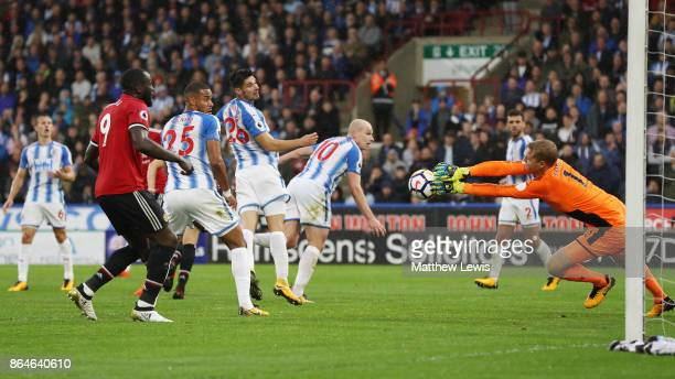 Jonas Lossl of Huddersfield Town makes a save from Ander Herrera of Manchester United during the Premier League match between Huddersfield Town and...