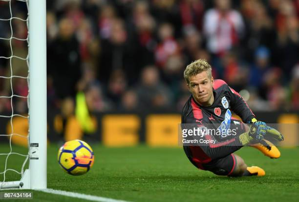 Jonas Lossl of Huddersfield Town watches the rebound from a penalty go wide during the Premier League match between Liverpool and Huddersfield Town...