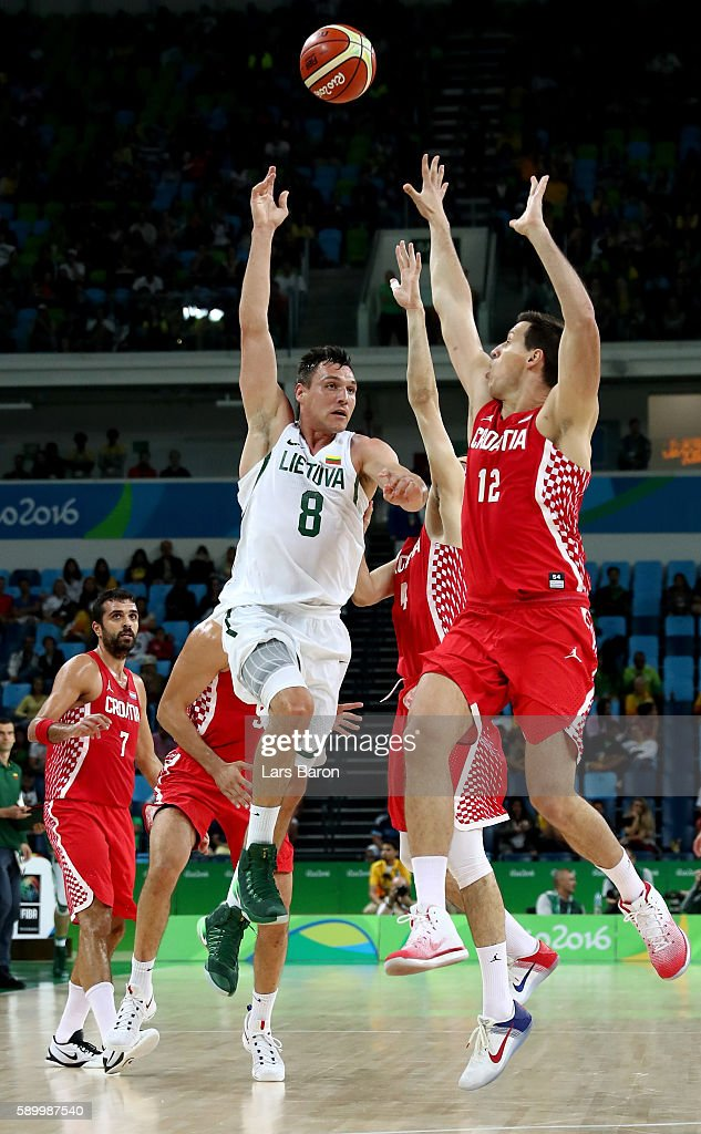 Jonas Maciulis of Lithuania is challenged by Darko Planinic of Croatia during a Men's Basketball Preliminary Round Group B game between Lithuania and Croatia on August 15, 2016 in Rio de Janeiro, Brazil.