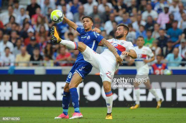 Jonas Martin of Strasbourg and Lucas Tousart of Lyon during the Ligue 1 match between Olympique Lyonnais and Strasbourg at Parc Olympique on August 5...