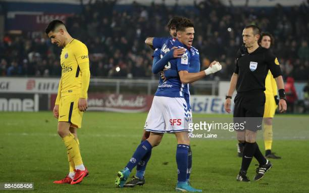 Jonas Martin of Strasbourg celebrate the victory and Yuri Berchiche of Paris SaintGermain is disapointed after the Ligue 1 match between Strasbourg...