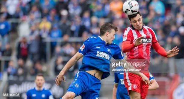 Jonas Meffert of Karlsruhe challenges Kaan Ayhan of Fortuna Duesseldorf during the Second Bundesliga match between Karlsruher SC and Fortuna...