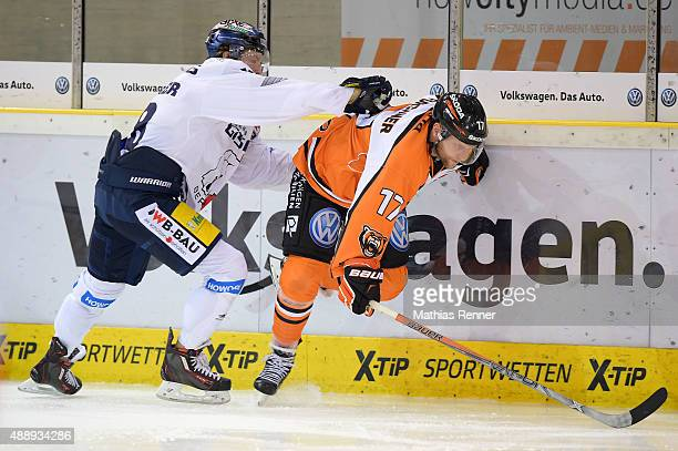Jonas Mueller of the Eisbaeren Berlin and Sebastian Furchner of Grizzly Wolfsburg during the game between Grizzlys Wolfsburg against Eisbaeren Berlin...