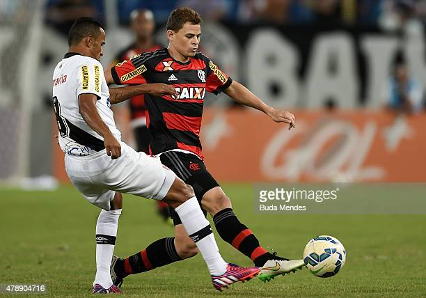 Jonas of Flamengo struggles for the ball with Serginho of Vasco during a match between Vasco and Flamengo as part of Brasileirao Series A 2015 at...