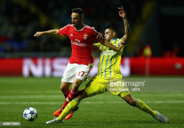 Jonas of SL Benfica is tackled by Roger Canas of FC Astana during the UEFA Champions League match between FC Astana and SL Benfica at the Astana...