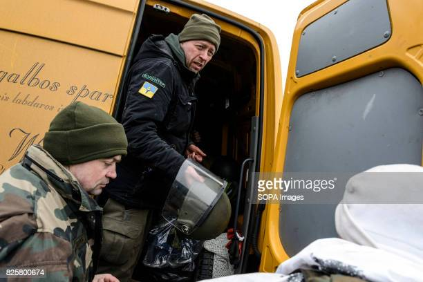 Jonas Ohman the head of Blue Yellow organisation is pictured while loading aid in the truck helped by Ukrainian soldiers Lithuanian volunteers raised...