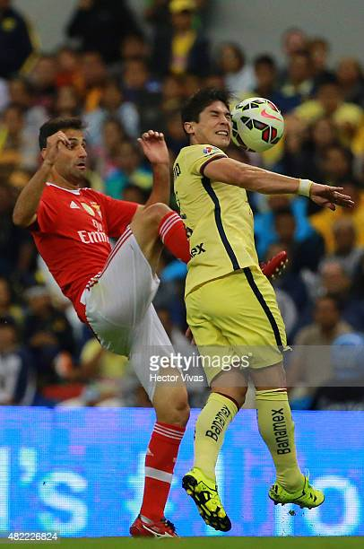 Jonas Oliveira of Benfica struggles for the ball with Javier Guemez of America during a match between America and Benfica as part of the...
