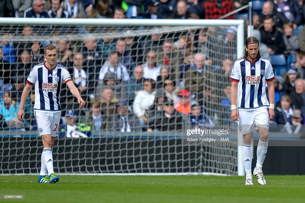 Jonas Olsson (R) and Darren Fletcher of West Bromwich Albion look dejected during the Barclays Premier League match between West Bromwich Albion and West Ham United at The Hawthorns on April 30, 2016 in West Bromwich, United Kingdom.