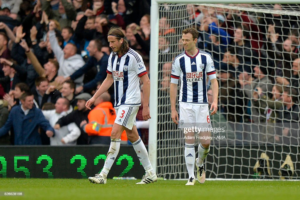 Jonas Olsson and Jonny Evans of West Bromwich Albion look dejected during the Barclays Premier League match between West Bromwich Albion and West Ham United at The Hawthorns on April 30, 2016 in West Bromwich, United Kingdom.