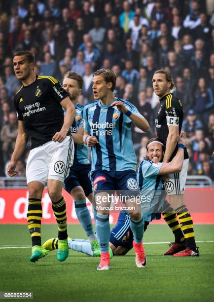 Jonas Olsson of Djurgardens IF holding on to NilsEric Johansson of AIK during the Allsvenskan match between Djurgardens IF and AIK at Tele2 Arena on...