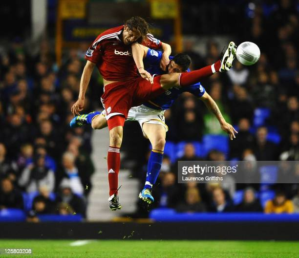 Jonas Olsson of West Bromwich Albion battles with Denis Stracqualursi of Everton during the Carling Cup Third Round match between Everton and West...