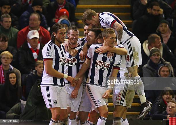 Jonas Olsson of West Bromwich Albion celebrates with team mates as he scores their second goal during the Barclays Premier League match between...
