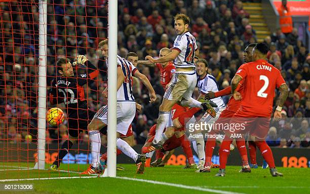 Jonas Olsson of West Bromwich Albion scores a goal to make it 12 during the Barclays Premier League match between Liverpool and West Bromwich Albion...