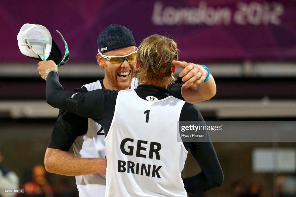 <a gi-track='captionPersonalityLinkClicked' href=/galleries/search?phrase=Jonas+Reckermann&family=editorial&specificpeople=228457 ng-click='$event.stopPropagation()'>Jonas Reckermann</a> and <a gi-track='captionPersonalityLinkClicked' href=/galleries/search?phrase=Julius+Brink&family=editorial&specificpeople=224931 ng-click='$event.stopPropagation()'>Julius Brink</a> of Germany celebrate after they won match point against Ricardo Santos and Pedro Cunha of Brazil during the Men's Beach Volleyball quarterfinal match between Germany and Brazil on Day 10 of the London 2012 Olympic Games at Horse Guards Parade August 6, 2012 in London, England.