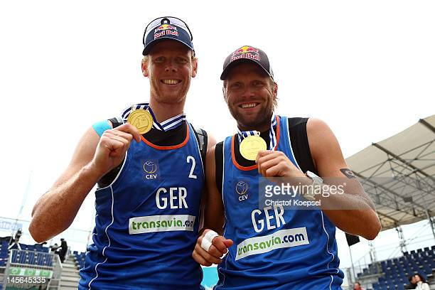 Jonas Reckermann and Julius Brink of Germany pose with their gold medal after winning the men's final match between Emiel Boersma and Daan Spijkers...