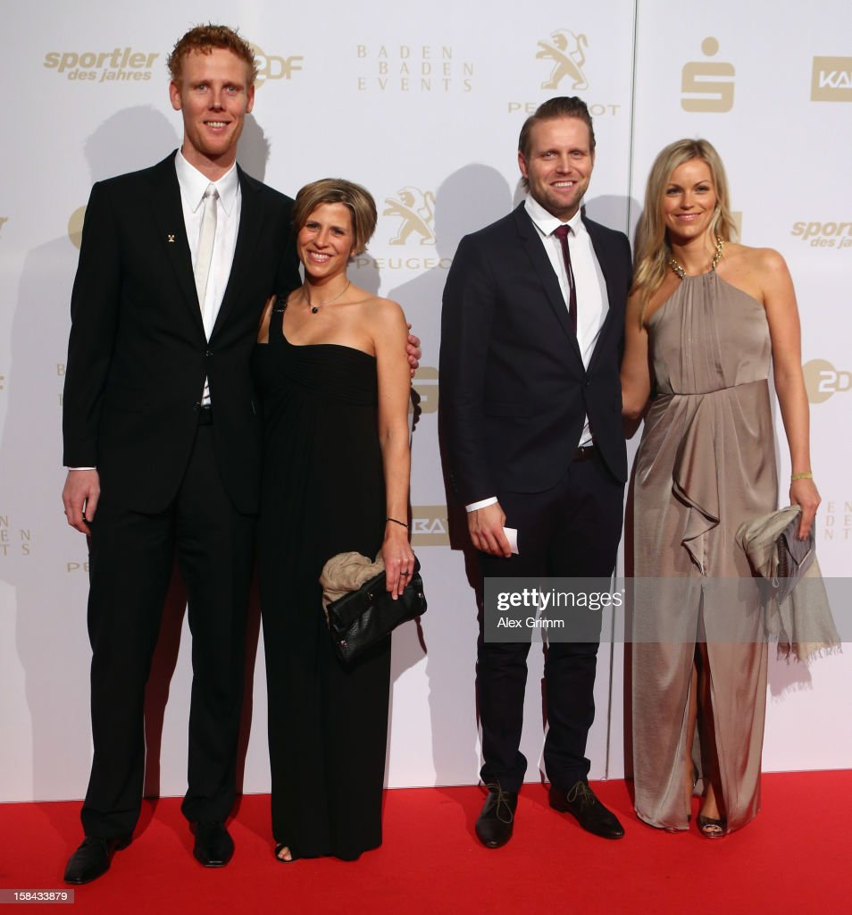 <a gi-track='captionPersonalityLinkClicked' href=/galleries/search?phrase=Jonas+Reckermann&family=editorial&specificpeople=228457 ng-click='$event.stopPropagation()'>Jonas Reckermann</a>, his wife Kati, <a gi-track='captionPersonalityLinkClicked' href=/galleries/search?phrase=Julius+Brink&family=editorial&specificpeople=224931 ng-click='$event.stopPropagation()'>Julius Brink</a> and his wife Verena (L-R) pose during the 'Athlete of the Year 2012' gala at the Kurhaus Baden-Baden on December 16, 2012 in Baden-Baden, Germany.