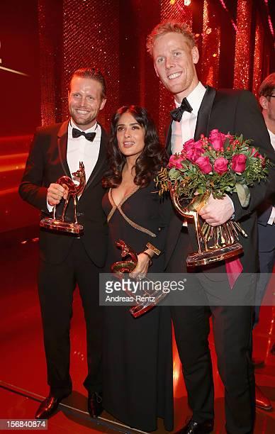 Jonas Reckermann Julius Brink Salma Hayek and Kirsten Bruhn attend 'BAMBI Awards 2012' at the Stadthalle Duesseldorf on November 22 2012 in...