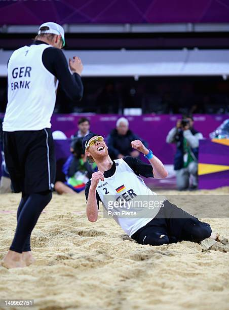 Jonas Reckermann of Germany and Julius Brink of Germany celebrate after winning match point during the Men's Beach Volleyball Semi Final match...