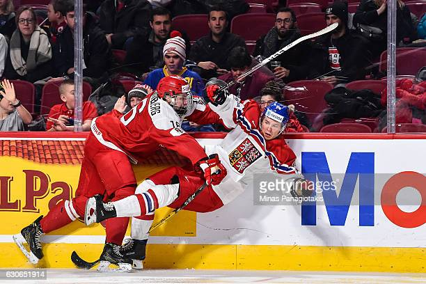 Jonas Rondbjerg of Team Denmark checks Filip Chlapik of Team Czech Republic during the 2017 IIHF World Junior Championship preliminary round game at...