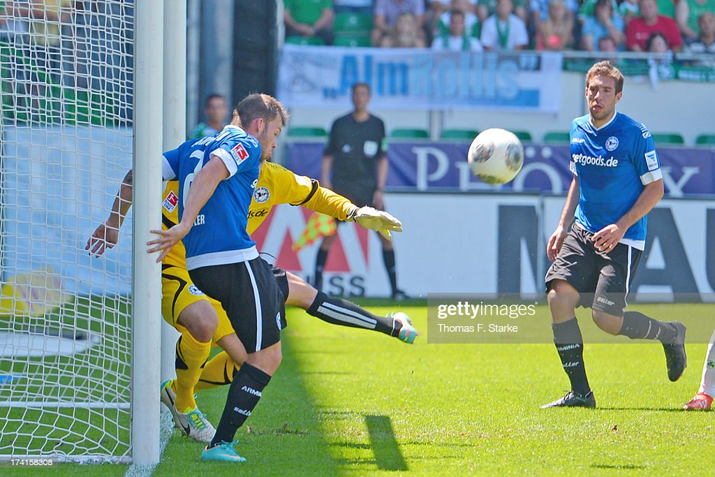 Jonas Strifler (FRONT) of Bielefeld clears the ball off the goalline during the Second Bundesliga match between Greuther Fuerth and Arminia Bielefeld at the Trolli Arena on July 21, 2013 in Fuerth, Germany.