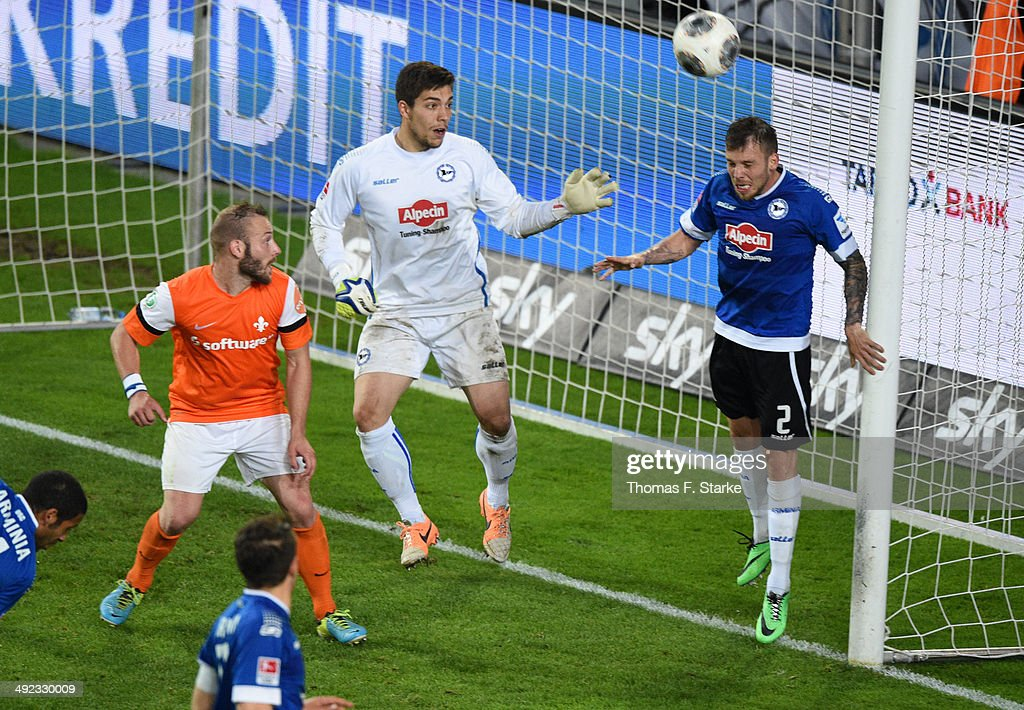 Jonas Strifler (R) of Bielefeld saves a kick during the Second Bundesliga Playoff Second Leg match between Arminia Bielefeld and Darmstadt 98 at Schueco Arena on May 19, 2014 in Bielefeld, Germany.
