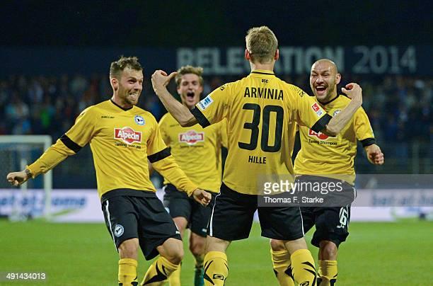 Jonas Strifler Tom Schuetz Sebastian Hille and Philipp Riese of Bielefeld celebrate during the Second Bundesliga Playoff First Leg match between...