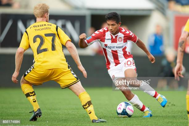 Jonas Thorsen of AC Horsens and Edison Flores of AaB Aalborg compete for the ball during the Danish Alka Superliga match between AC Horsens and AaB...