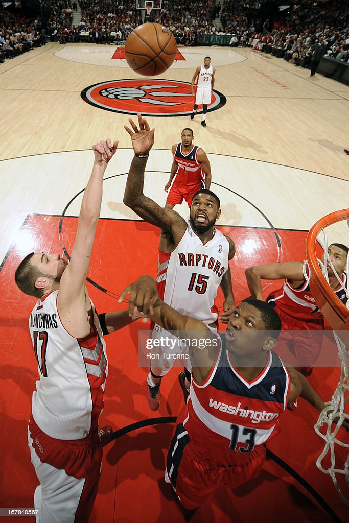 <a gi-track='captionPersonalityLinkClicked' href=/galleries/search?phrase=Jonas+Valanciunas&family=editorial&specificpeople=5654195 ng-click='$event.stopPropagation()'>Jonas Valanciunas</a> #17 and <a gi-track='captionPersonalityLinkClicked' href=/galleries/search?phrase=Amir+Johnson&family=editorial&specificpeople=556786 ng-click='$event.stopPropagation()'>Amir Johnson</a> #15 of the Toronto Raptors go up for a rebound against the Washington Wizards on April 3, 2013 at the Air Canada Centre in Toronto, Ontario, Canada.