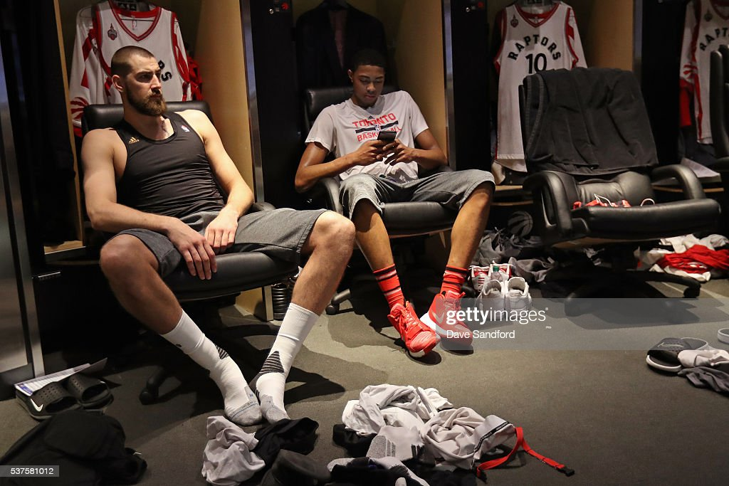 <a gi-track='captionPersonalityLinkClicked' href=/galleries/search?phrase=Jonas+Valanciunas&family=editorial&specificpeople=5654195 ng-click='$event.stopPropagation()'>Jonas Valanciunas</a> #17 and <a gi-track='captionPersonalityLinkClicked' href=/galleries/search?phrase=Bruno+Caboclo&family=editorial&specificpeople=12933791 ng-click='$event.stopPropagation()'>Bruno Caboclo</a> #20 of the Toronto Raptors sit by their lockers before Game Six of the NBA Eastern Conference Finals against the Cleveland Cavaliers at Air Canada Centre on May 27, 2016 in Toronto, Ontario, Canada.