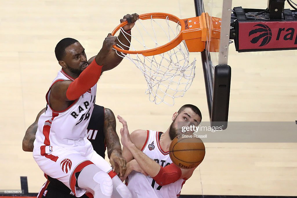 Jonas Valanciunas gets out of the way of a Patrick Patterson dunk as the Raptors end a long run by the Heat as the Toronto Raptors play the Miami Heat in game two of their Eastern Conference Semifinal at the Air Canada Centre in Toronto. May 5, 2016.