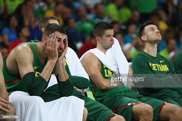 Jonas Valanciunas of Lithuania looks on from the bench during the Men's Preliminary Round Group B between Spain and Lithuania on Day 8 of the Rio...