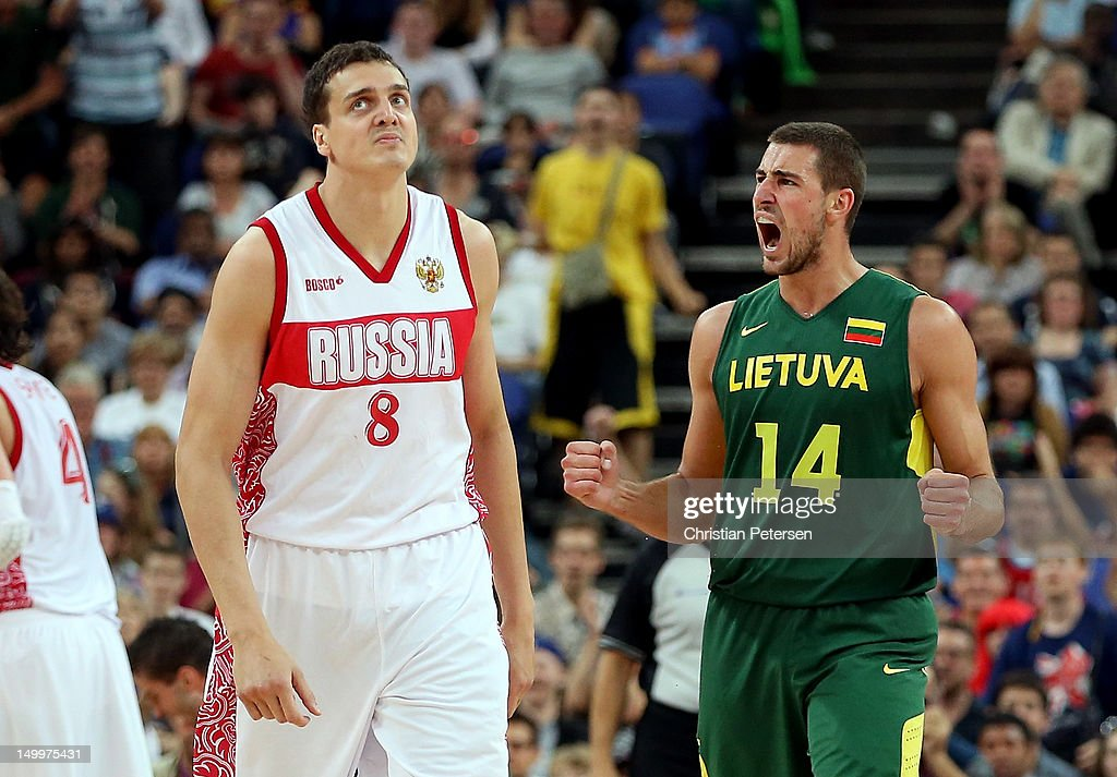 Jonas Valanciunas #14 of Lithuania reacts alongside Alexander Kaun #8 of Russia in the second half during the Men's Basketball quaterfinal game on Day 12 of the London 2012 Olympic Games at North Greenwich Arena on August 8, 2012 in London, England.