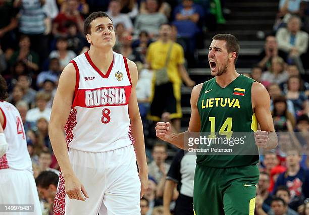 Jonas Valanciunas of Lithuania reacts alongside Alexander Kaun of Russia in the second half during the Men's Basketball quaterfinal game on Day 12 of...