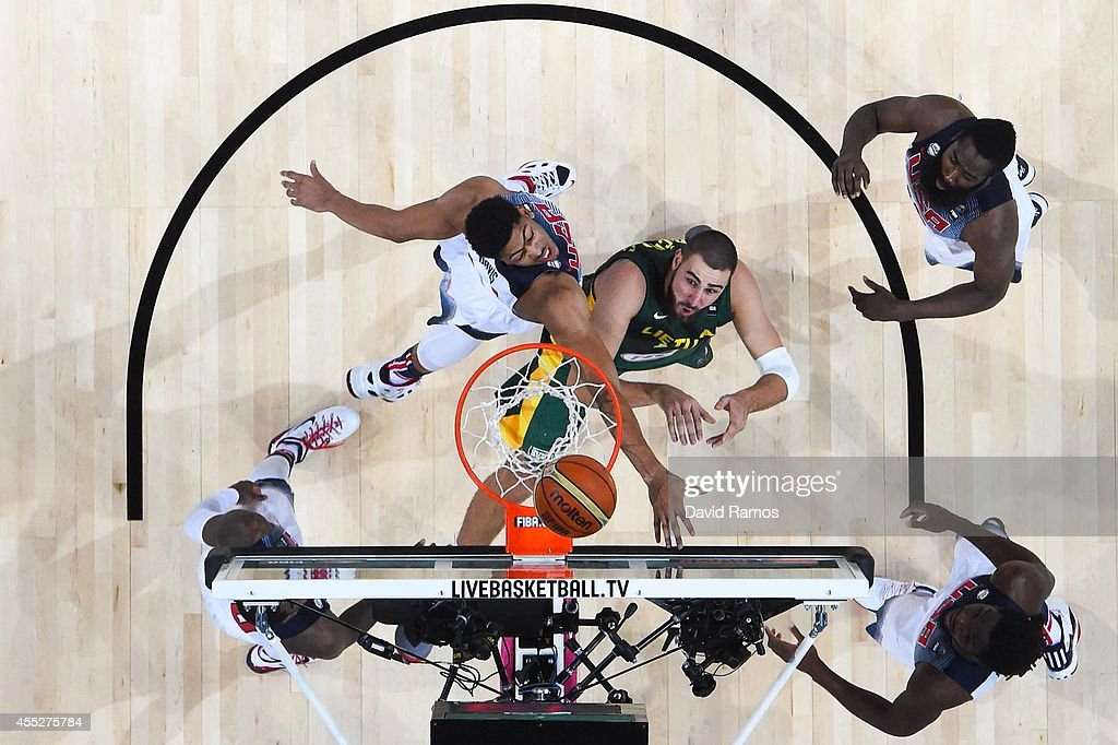 Jonas Valanciunas #14 of the Lithuania Basketball Men's National Team fightrs for the ball against USA Basketball Men's National Team during a 2014 FIBA Basketball World Cup semi-final match between USA and Lithuania at Palau Sant Jordi on September 11, 2014 in Barcelona, Spain.