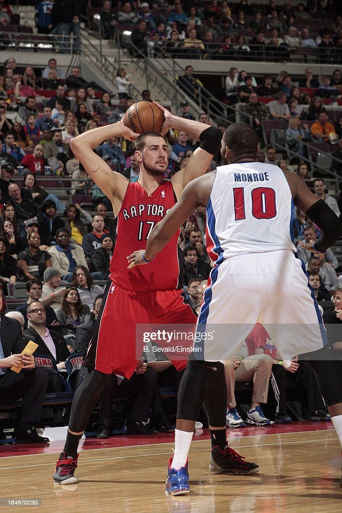 Jonas Valanciunas #17 of the Toronto Raptors aims over Greg Monroe #10 of the Detroit Pistons during the game between the Detroit Pistons and the Toronto Raptors on March 29, 2013 at The Palace of Auburn Hills in Auburn Hills, Michigan.