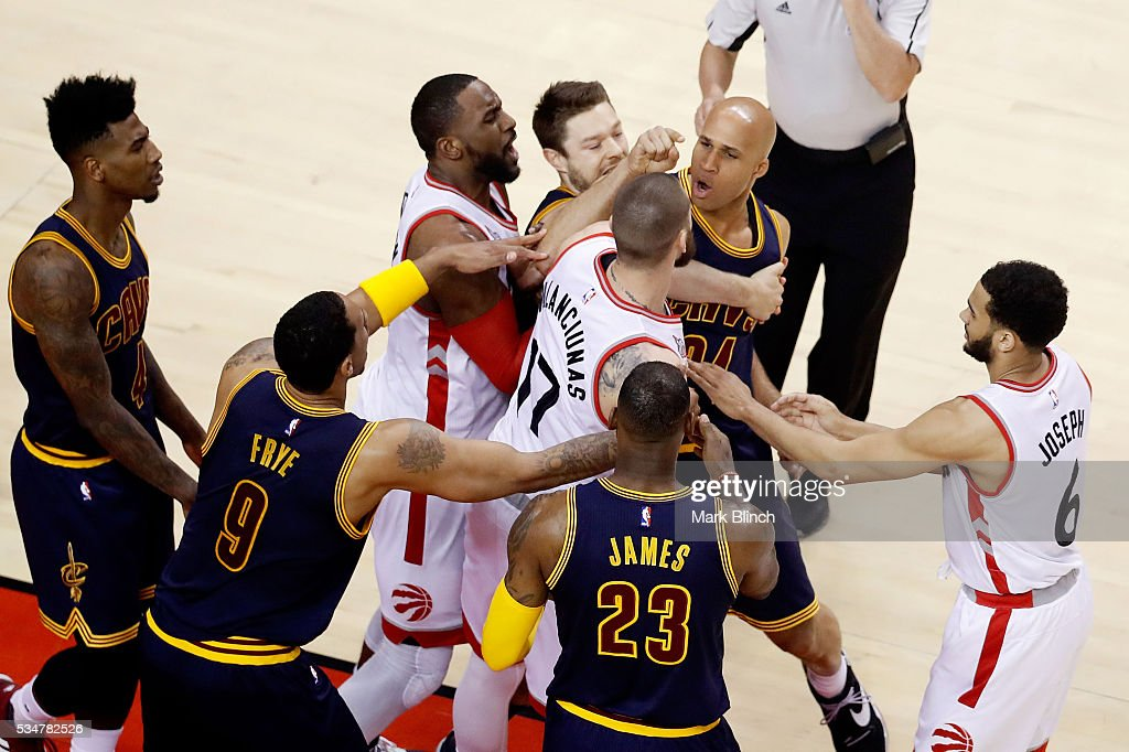<a gi-track='captionPersonalityLinkClicked' href=/galleries/search?phrase=Jonas+Valanciunas&family=editorial&specificpeople=5654195 ng-click='$event.stopPropagation()'>Jonas Valanciunas</a> #17 of the Toronto Raptors and <a gi-track='captionPersonalityLinkClicked' href=/galleries/search?phrase=Richard+Jefferson&family=editorial&specificpeople=201688 ng-click='$event.stopPropagation()'>Richard Jefferson</a> #24 of the Cleveland Cavaliers exchange words as <a gi-track='captionPersonalityLinkClicked' href=/galleries/search?phrase=Matthew+Dellavedova&family=editorial&specificpeople=5948739 ng-click='$event.stopPropagation()'>Matthew Dellavedova</a> #8 holds back Jefferson in the second quarter of game six of the Eastern Conference Finals during the 2016 NBA Playoffs at Air Canada Centre on May 27, 2016 in Toronto, Canada.