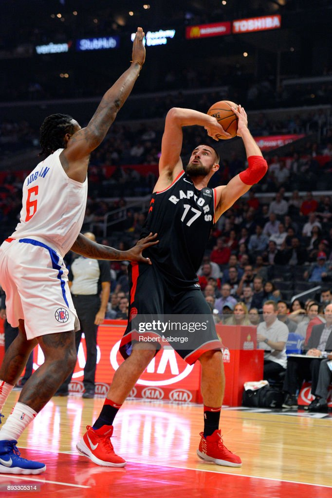 Jonas Valanciunas #17 of the Toronto Raptors attempts a shot against DeAndre Jordan #6 of the Los Angeles Clippers on December 11, 2017 at STAPLES Center in Los Angeles, California.