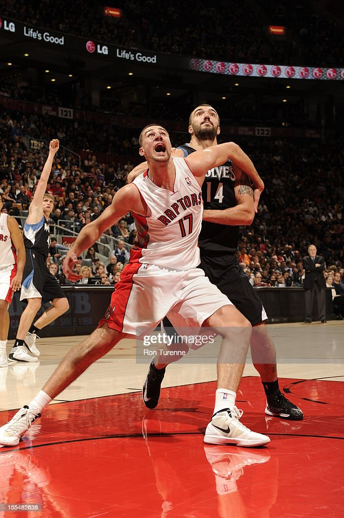 Jonas Valanciunas #17 of the Toronto Raptors battles Nikola Pekovic #14 of Minnesota Timberwolves for a rebound during the game on November 4, 2012 at the Air Canada Centre in Toronto, Ontario, Canada.