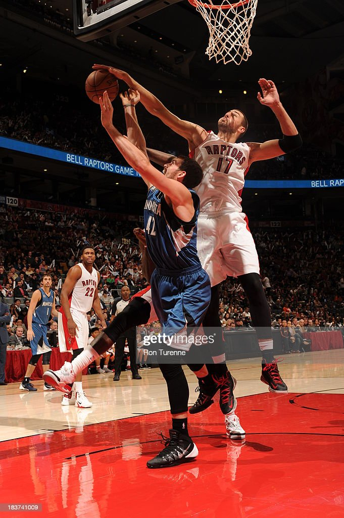 <a gi-track='captionPersonalityLinkClicked' href=/galleries/search?phrase=Jonas+Valanciunas&family=editorial&specificpeople=5654195 ng-click='$event.stopPropagation()'>Jonas Valanciunas</a> #17 of the Toronto Raptors blocks a shot against <a gi-track='captionPersonalityLinkClicked' href=/galleries/search?phrase=Kevin+Love&family=editorial&specificpeople=4212726 ng-click='$event.stopPropagation()'>Kevin Love</a> #42 of the Minnesota Timberwolves during the game on October 9, 2013 at the Air Canada Centre in Toronto, Ontario, Canada.