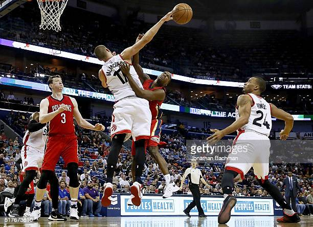 Jonas Valanciunas of the Toronto Raptors blocks a shot from Toney Douglas of the New Orleans Pelicans during a game at the Smoothie King Center on...
