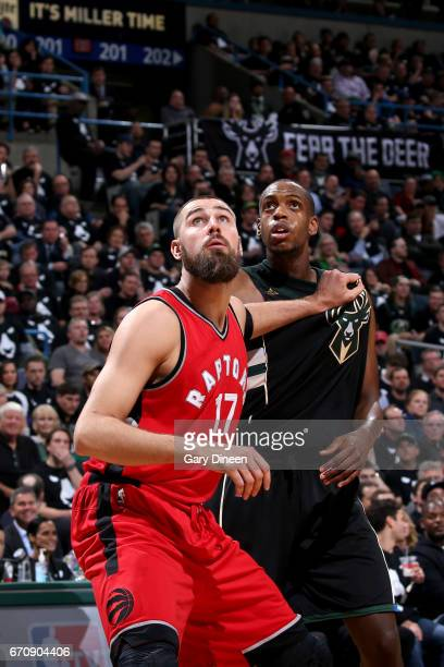 Jonas Valanciunas of the Toronto Raptors boxes out Khris Middleton of the Milwaukee Bucks during Game Three of the Eastern Conference Quarterfinals...