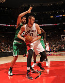Jonas Valanciunas of the Toronto Raptors controls the ball against Vitor Faverani of the Boston Celtics during the game on October 16 2013 at the Air...