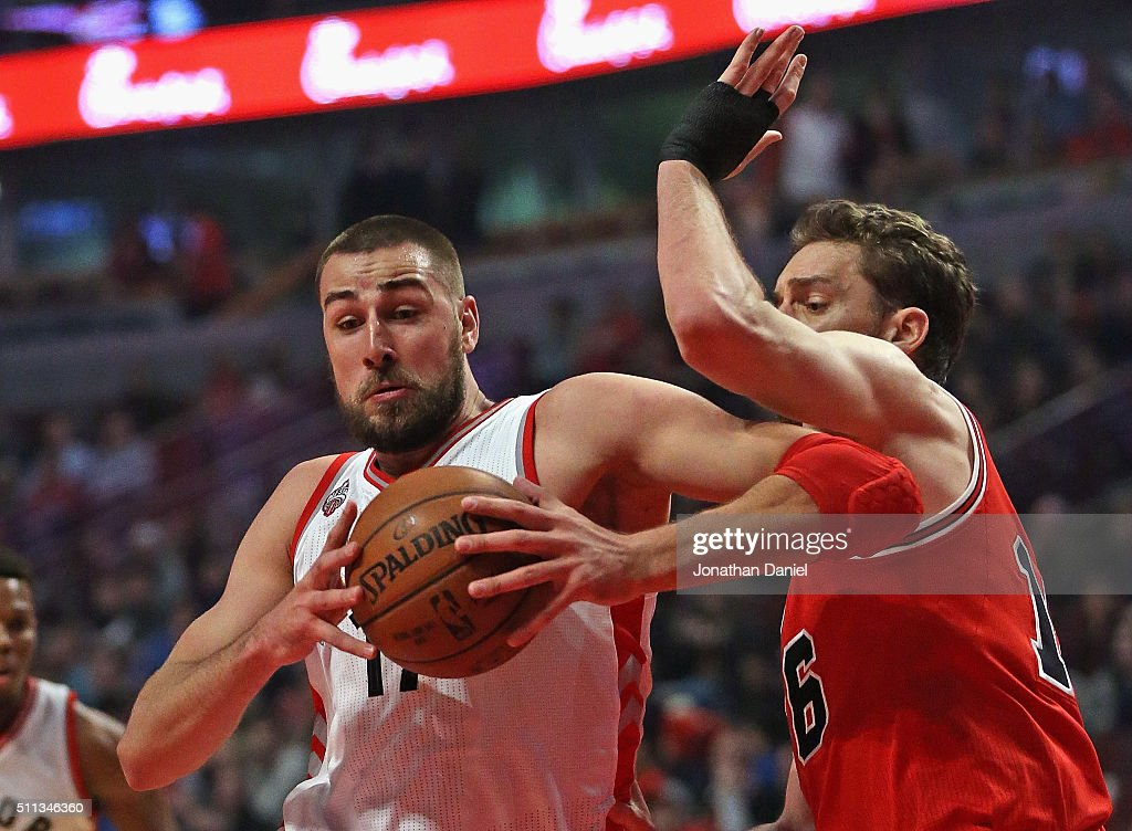 <a gi-track='captionPersonalityLinkClicked' href=/galleries/search?phrase=Jonas+Valanciunas&family=editorial&specificpeople=5654195 ng-click='$event.stopPropagation()'>Jonas Valanciunas</a> #17 of the Toronto Raptors drives against <a gi-track='captionPersonalityLinkClicked' href=/galleries/search?phrase=Pau+Gasol&family=editorial&specificpeople=201587 ng-click='$event.stopPropagation()'>Pau Gasol</a> #16 of the Chicago Bulls at the United Center on February 19, 2016 in Chicago, Illinois.