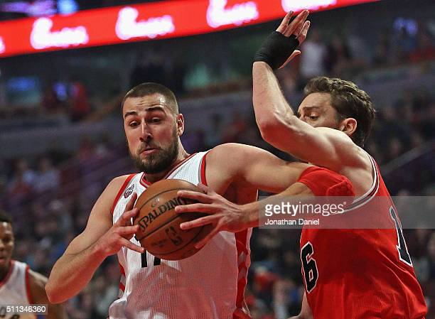 Jonas Valanciunas of the Toronto Raptors drives against Pau Gasol of the Chicago Bulls at the United Center on February 19 2016 in Chicago Illinois...