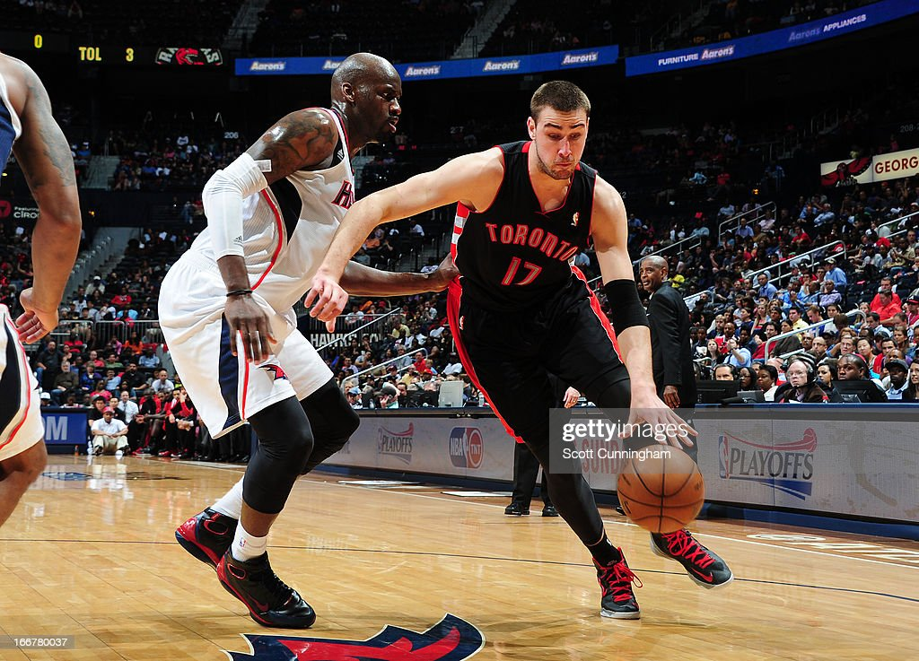 <a gi-track='captionPersonalityLinkClicked' href=/galleries/search?phrase=Jonas+Valanciunas&family=editorial&specificpeople=5654195 ng-click='$event.stopPropagation()'>Jonas Valanciunas</a> #17 of the Toronto Raptors drives baseline against the Atlanta Hawks on April 16, 2013 at Philips Arena in Atlanta, Georgia.