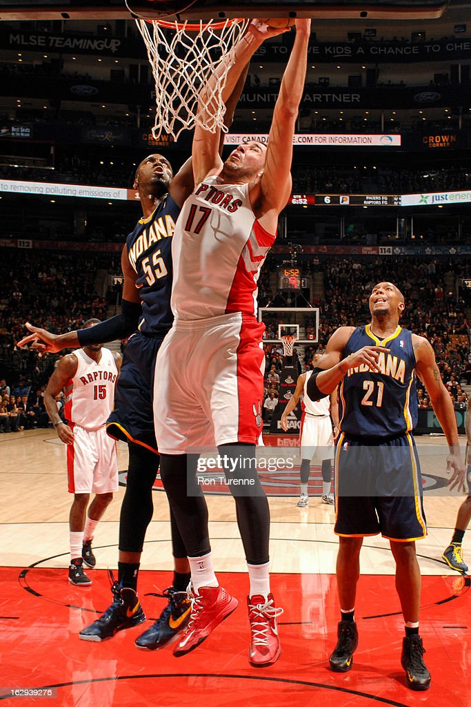Jonas Valanciunas #17 of the Toronto Raptors drives to the basket against Roy Hibbert #55 of the Indiana Pacers on March 1, 2013 at the Air Canada Centre in Toronto, Ontario, Canada.